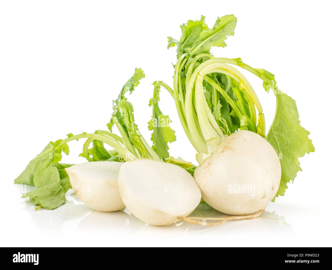 White radish bulbs with fresh leaves isolated on white background one whole and cut in two halves Stock Photo