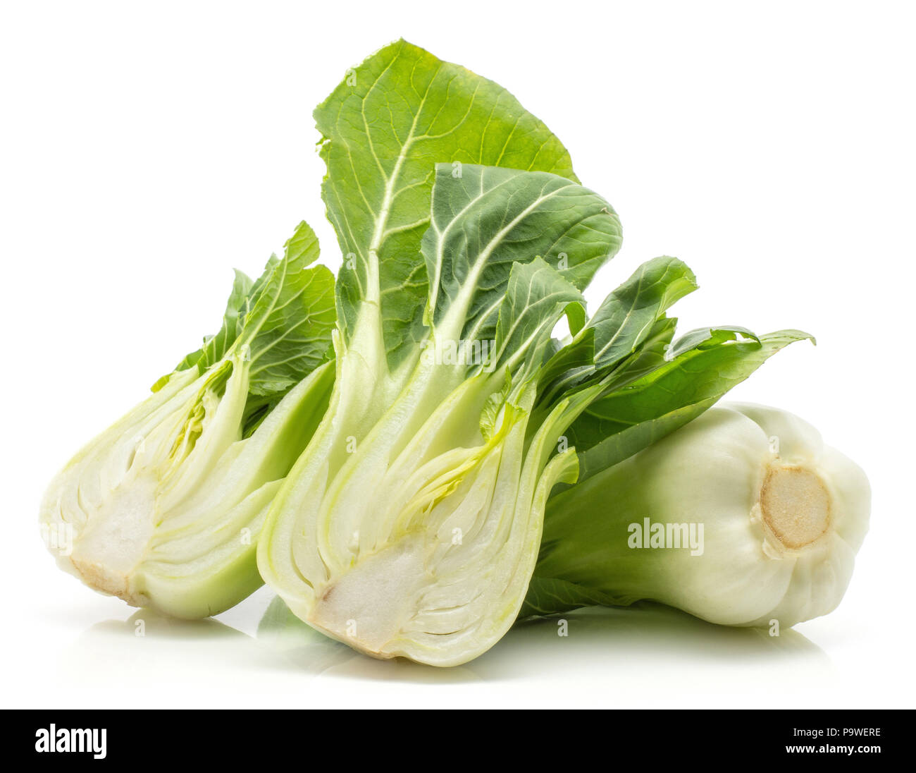 Bok choy (Pak choi) one cabbage and two sliced halves isolated on white background - Stock Image
