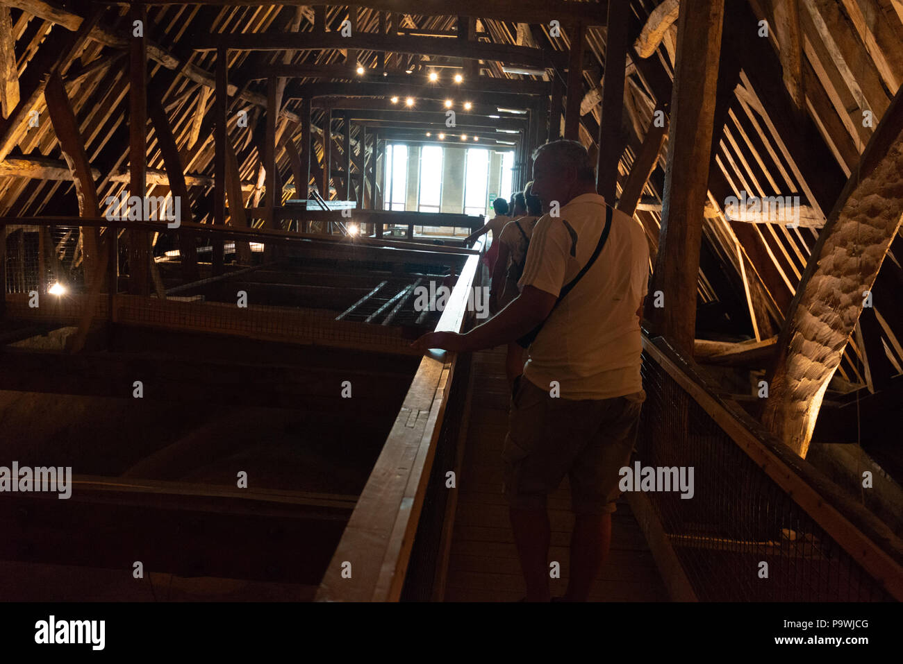 Inside the roof space of Salisbury Cathedral, Wiltshire, England, UK with ancient timbers visible on the tower tour. - Stock Image