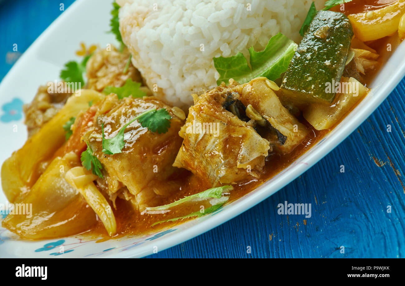 Seychelles fish curry  with coconut rice , traditional Seychellois recipe for a typical curry of red snapper cooked in fish stock. - Stock Image