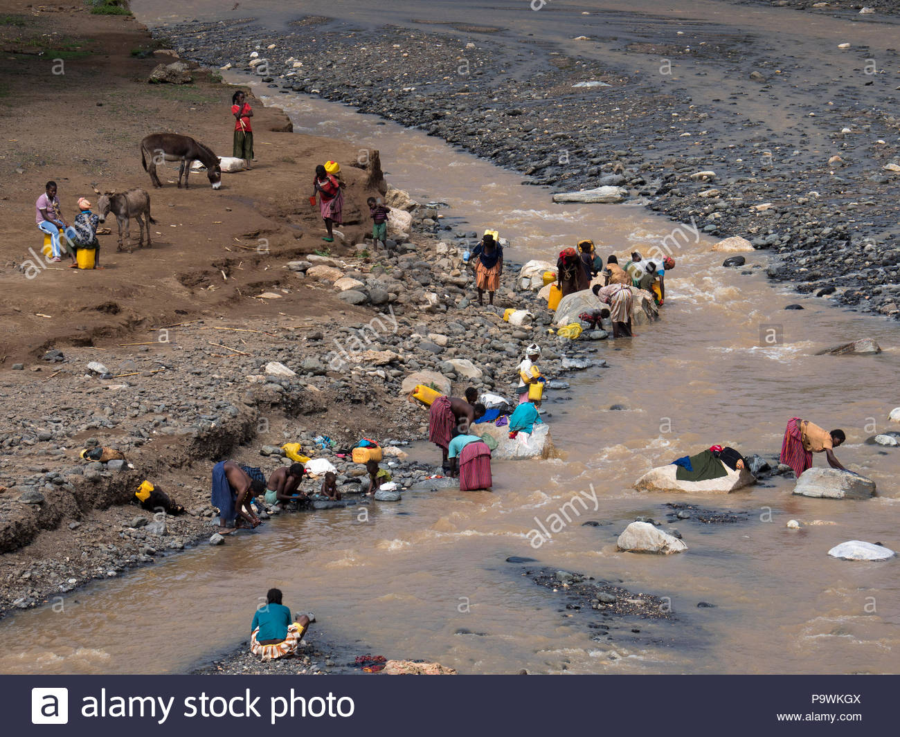 Women doing laundry at the river, Ethiopia - Stock Image