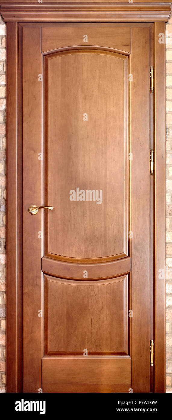 Wooden Interior Door Made Of Maple Wood With Brass Handle And With  Geometric Ornament On Brick Background