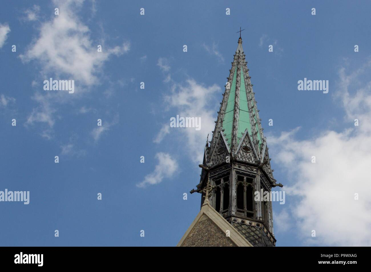 The Harrow School Chapel featuring a green Church Spire. It is a grade II listed building built 1854-57 on High Street, Harrow-On-The-Hill - Stock Image