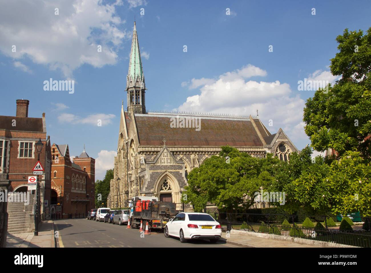 Harrow School Chapel with a green Church spire, which is a grade II listed building, on Harrow-On-The-Hill, London - Stock Image