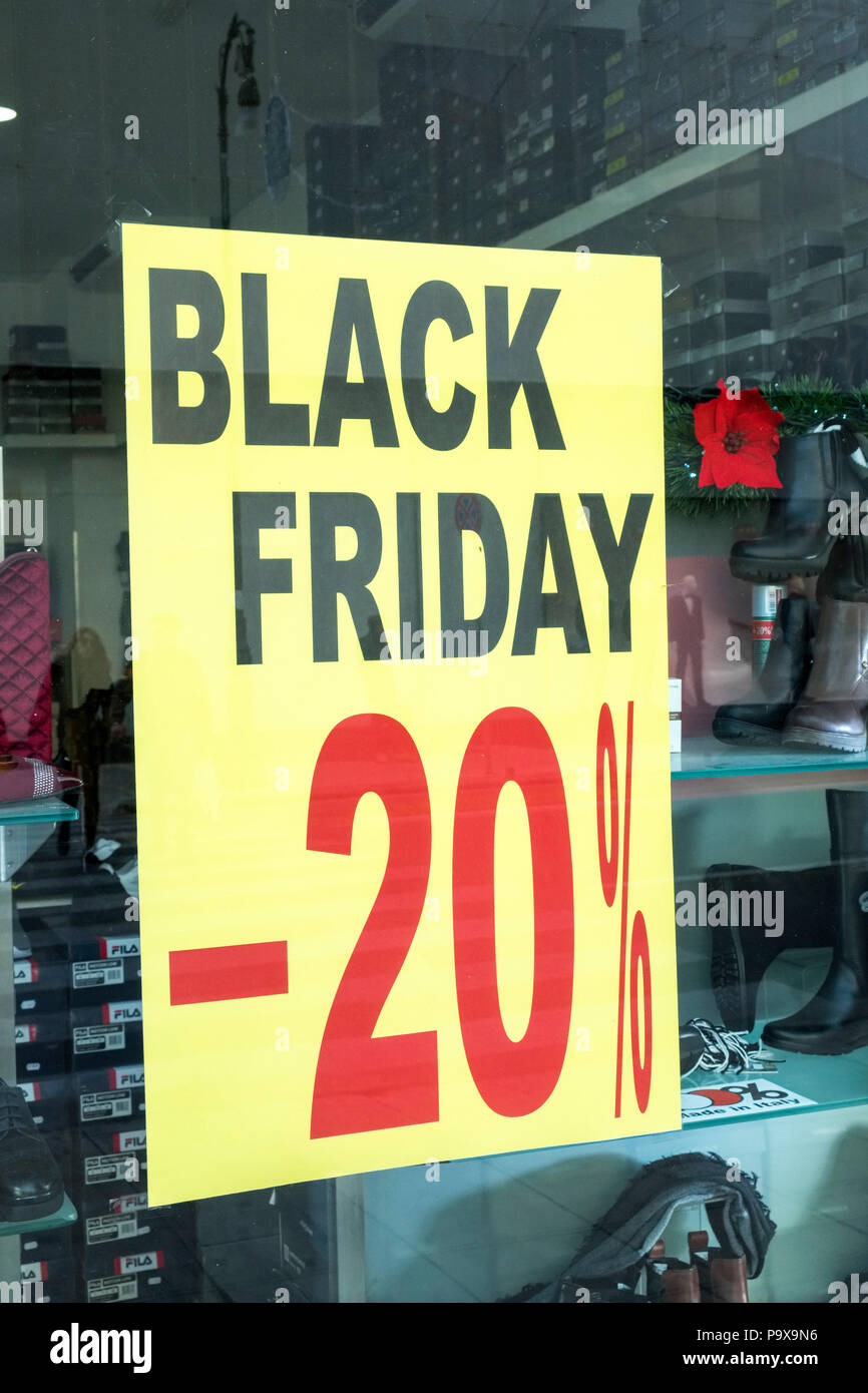 Black Friday Sale sales price reduction discount poster in a shop window, England UK - Stock Image