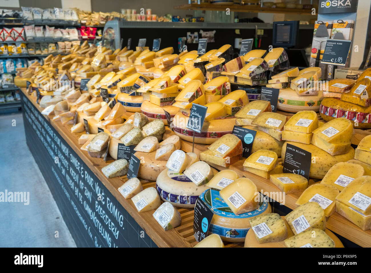 Cheeses on display in a cheese shop in Amsterdam, Netherlands, Holland, Europe - Stock Image