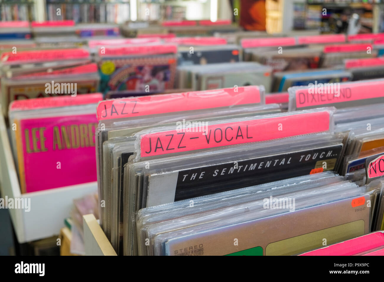 Vinyl records LPs and albums in racks at a record shop interior, England, UK - Stock Image