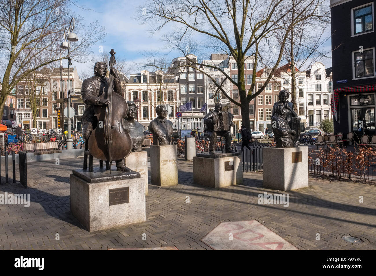 Five statues of famous singers and musicians on the Elandsgracht in Amsterdam, Netherlands, Europe - Stock Image