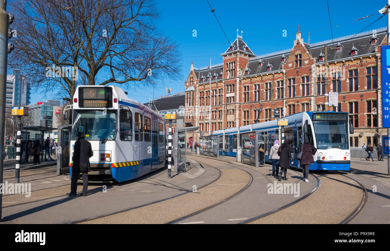 Trams streetcars outside Amsterdam Centraal Station, Amsterdam, Netherlands, Holland, Europe - Stock Image