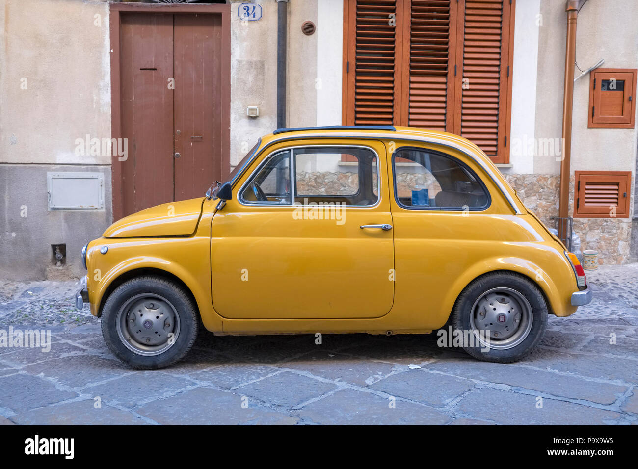 A Fiat 500 car, in Cefalu, Sicily, Italy, Europe - Stock Image
