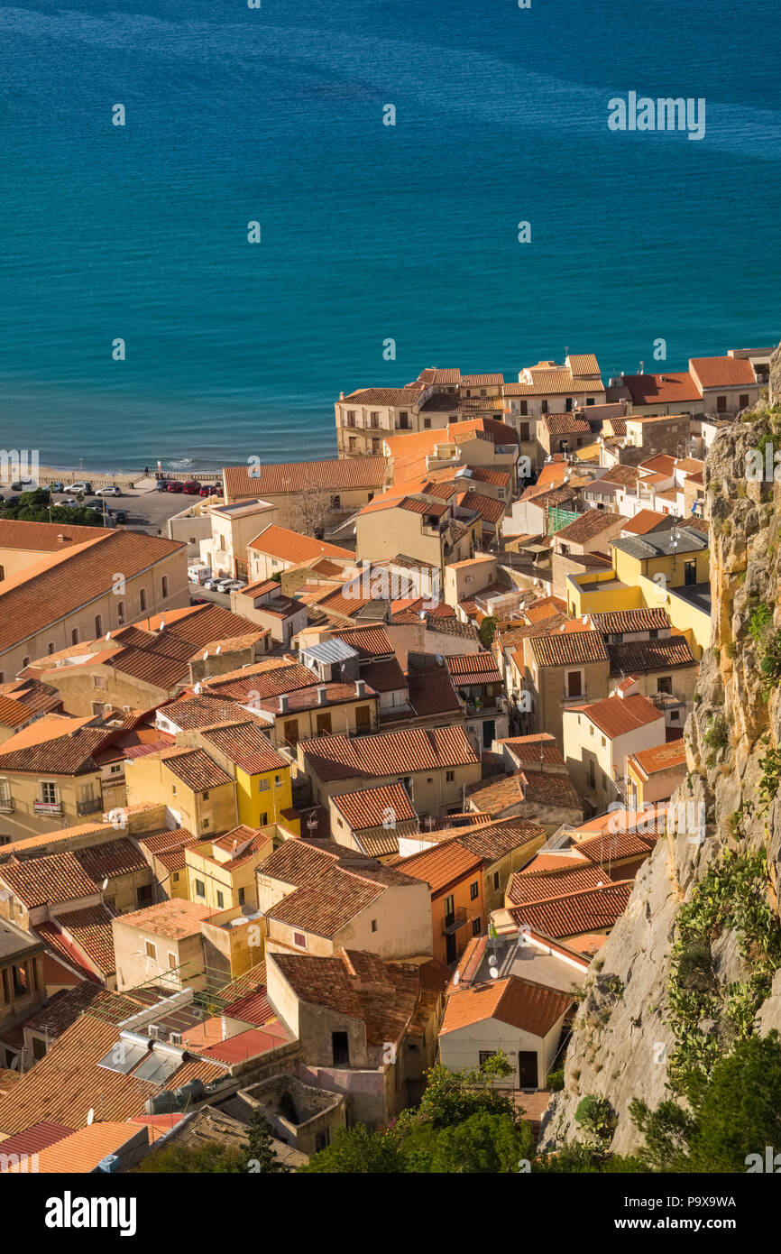 Aerial view of the packed crowded city and red rooftops of Cefalu, Sicily, Italy, Europe - Stock Image