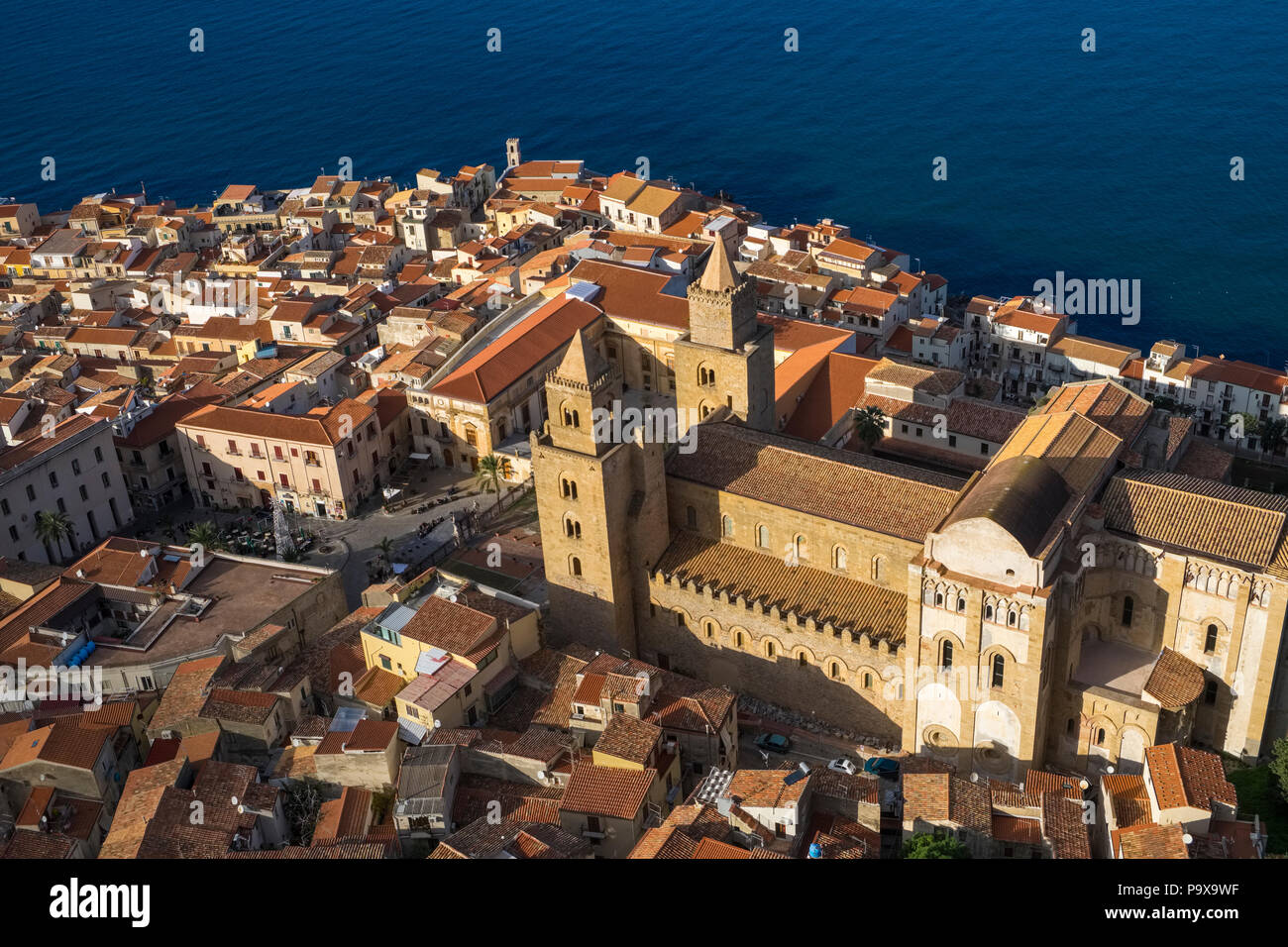 Aerial view of Cefalu Cathedral and red rooftops buildings architecture, Cefalu, Sicily, Italy, Europe - Stock Image
