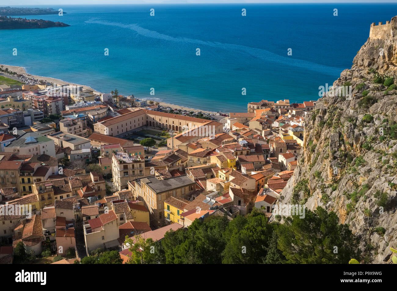 Aerial view of the city and red rooftops of Cefalu, Sicily, Italy, Europe - Stock Image