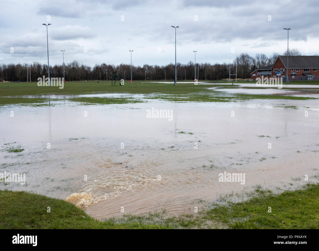 Burst water pipe flooding rugby club pitches in north east England. UK - Stock Image