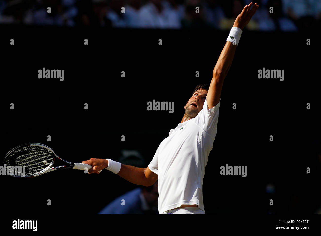 London, England - July 7, 2018.  Wimbledon Tennis: Novak Djokovic during his third round match against Great Britain's Kyle Edmund on Center Court at Wimbledon today. - Stock Image