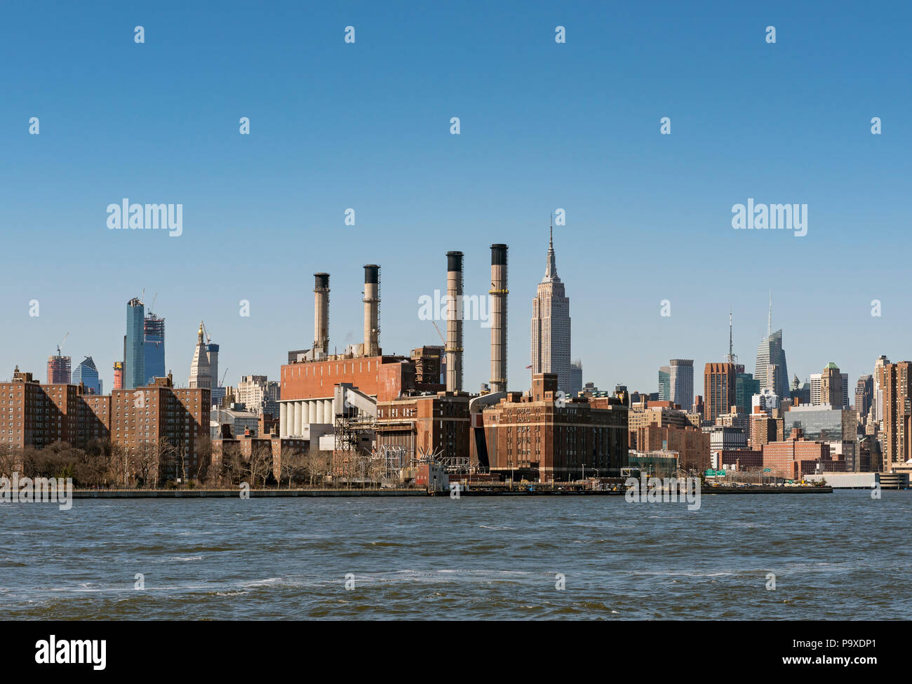 Consolidated Edison Power Plant in Manhattan seen from East River, New York City, USA - Stock Image