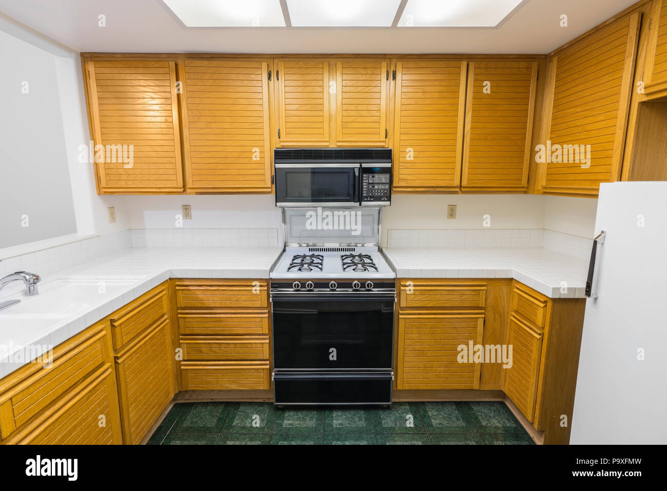 Old Condo Kitchen With Oak Cabinets Tile Countertops Gas