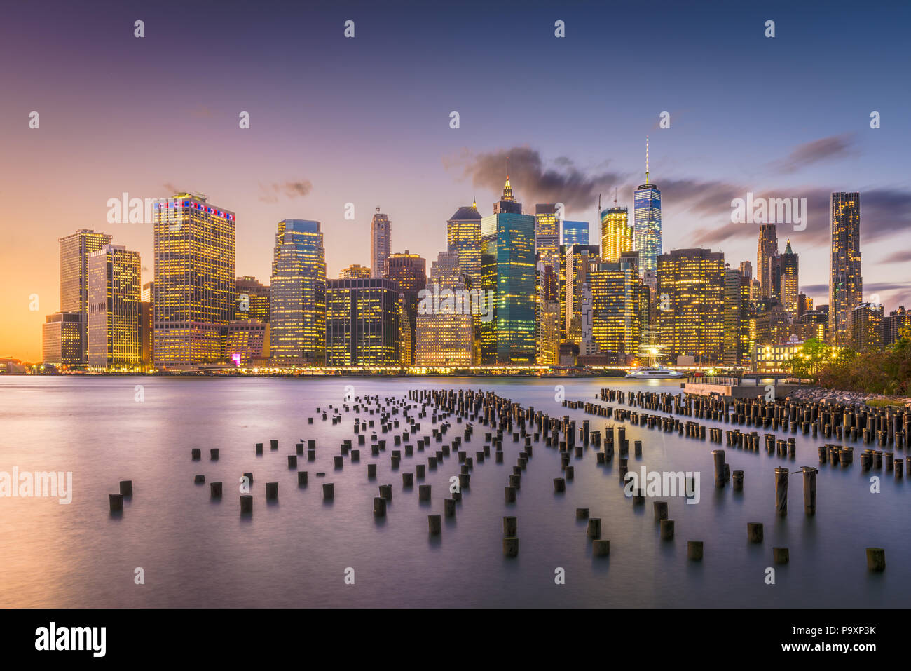 New York, New York, USA downtown skyline at dusk on the East River. - Stock Image