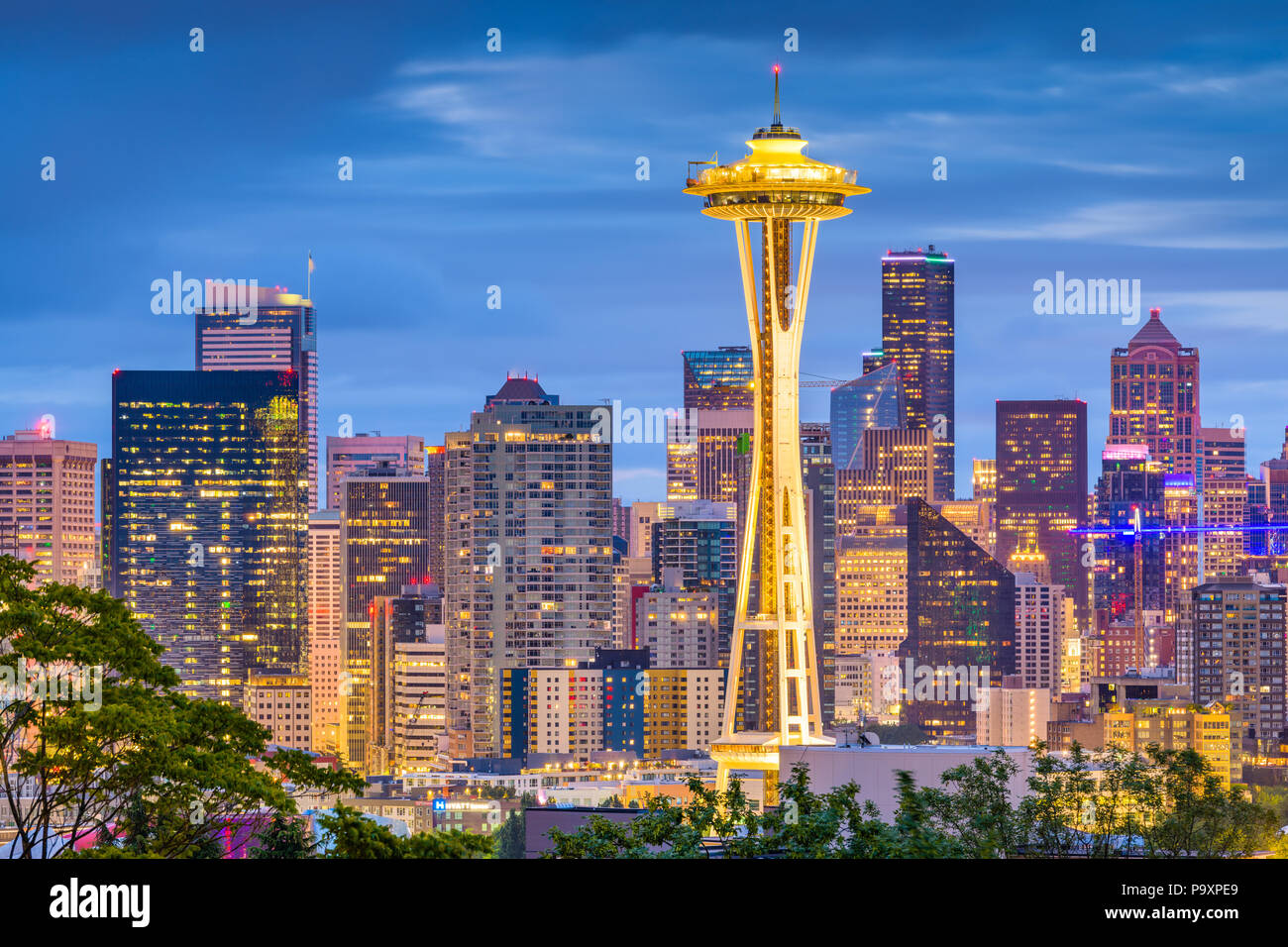 SEATTLE, WASHINGTON - JUNE 26, 2018: The Space Needle towers in front of the downtown Seattle skyline at dusk. - Stock Image