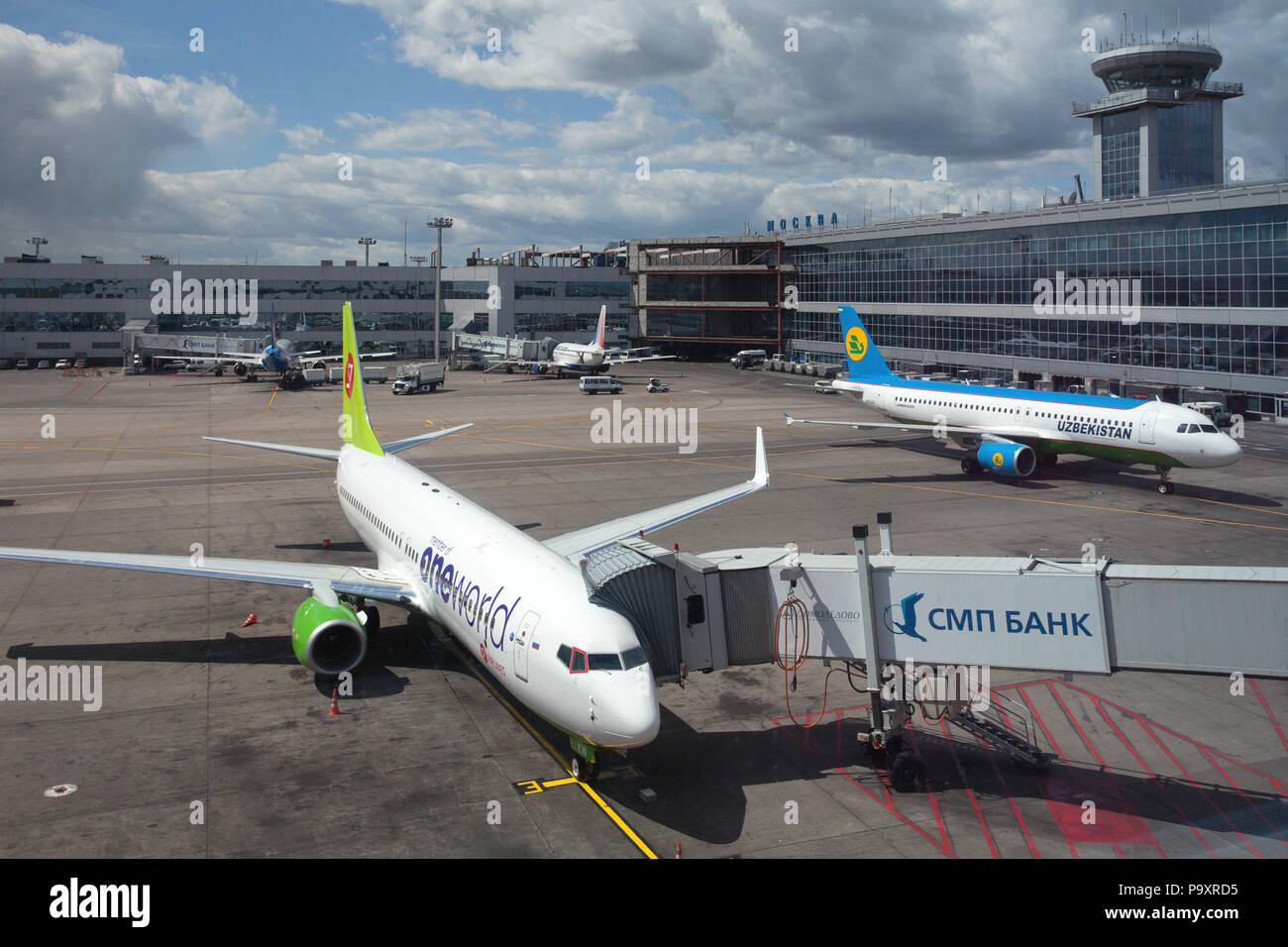 Civil jet aircrafts of S7 Airlines and Uzbekistan Airways at Domodedovo airport, Moscow, Russia - Stock Image