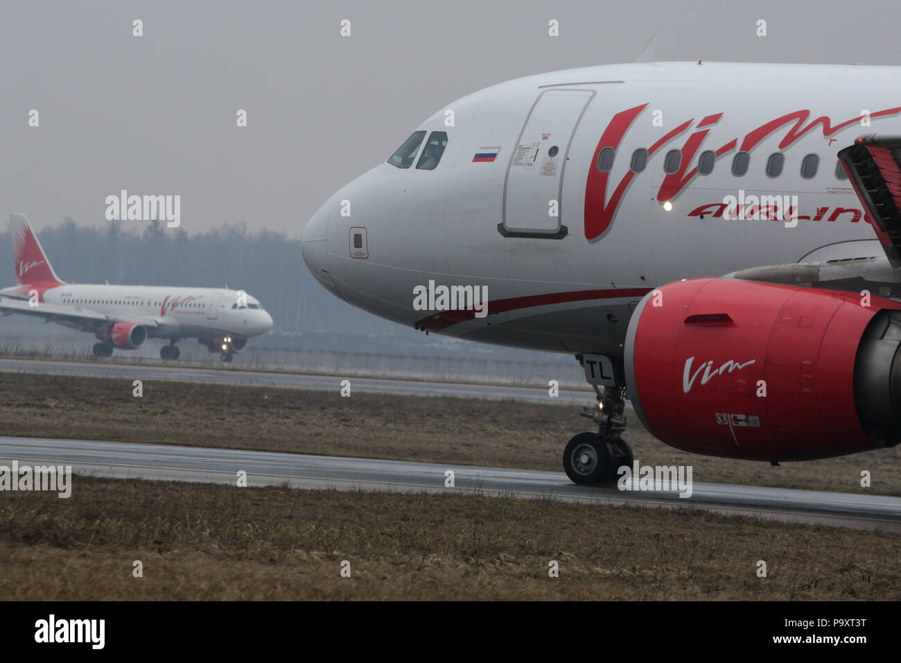 Two Airbus A319 civil jet airplanes of VIM Airlines at Domodedovo airport, Moscow, Russia. - Stock Image