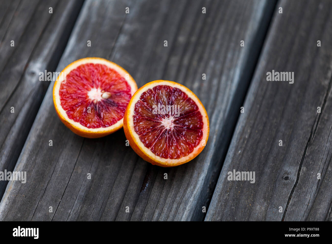 Healthy blood oranges on display. - Stock Image