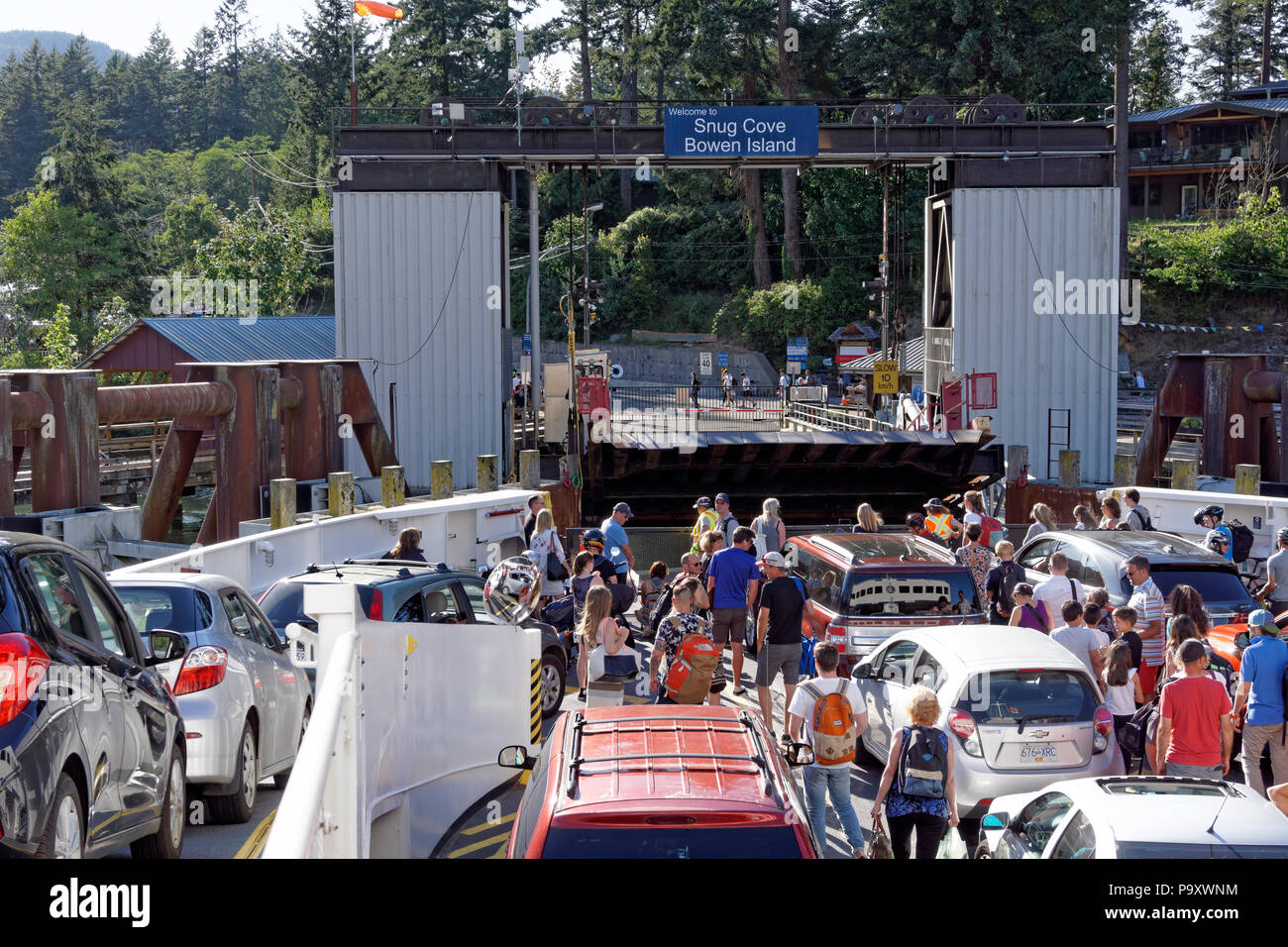 BC Ferries passenger and car ferry docking at the Snug Cover terminal on Bowen Island near Vancouver, British Columbia,, Canada - Stock Image