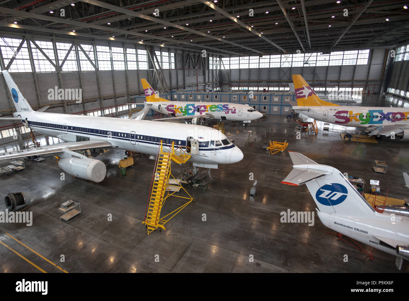 Civil jet aircrafts of various Russian commercial airlines undergoing maintenance at Vnukovo Repair Plant (VARZ-400) at Vnukovo airpot, Moscow, Russia - Stock Image