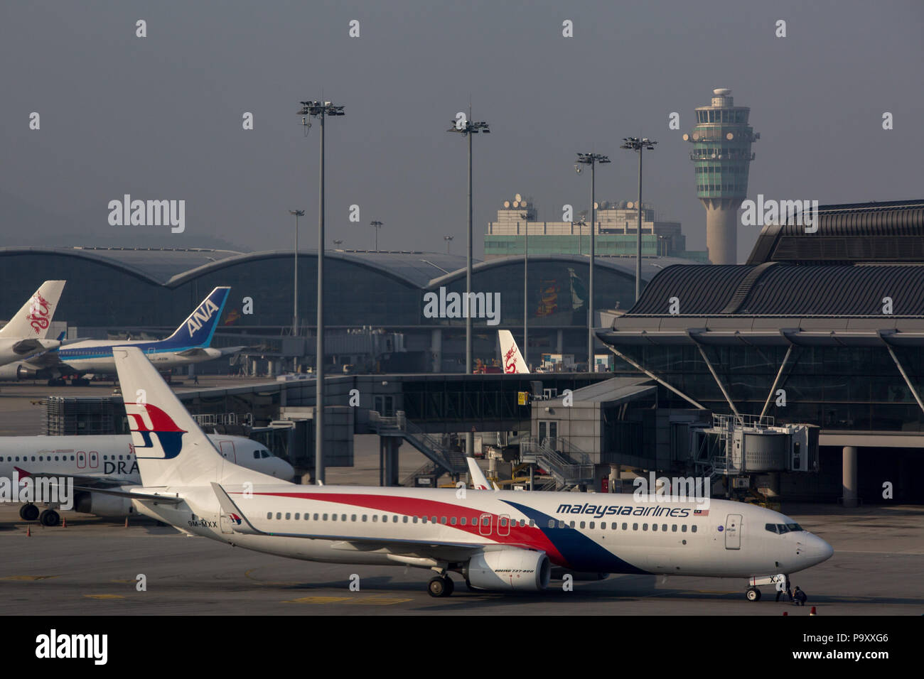 The Boeing 737-800 civil jet airplane of Malaysia Airlines at Chek Lap Kok Airport, Hong Kong, China - Stock Image
