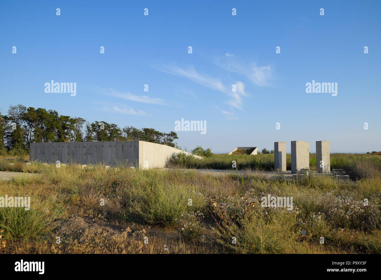 Abandoned construction site of the military facility. Forgotten structure. - Stock Image