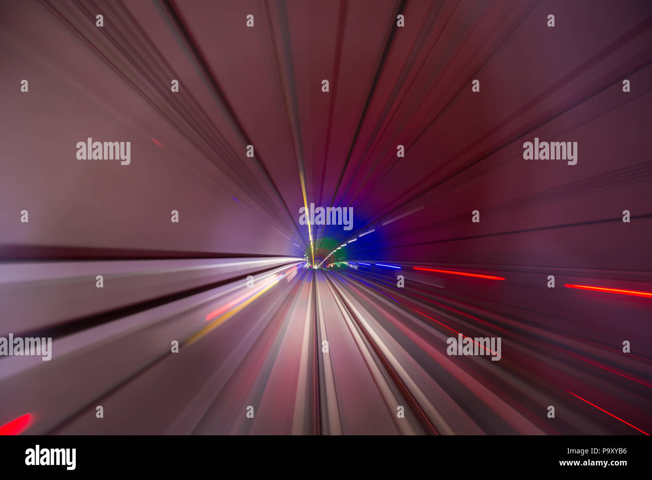 Speed blurred motion of train or subway train moving inside tunnel. Stock Photo