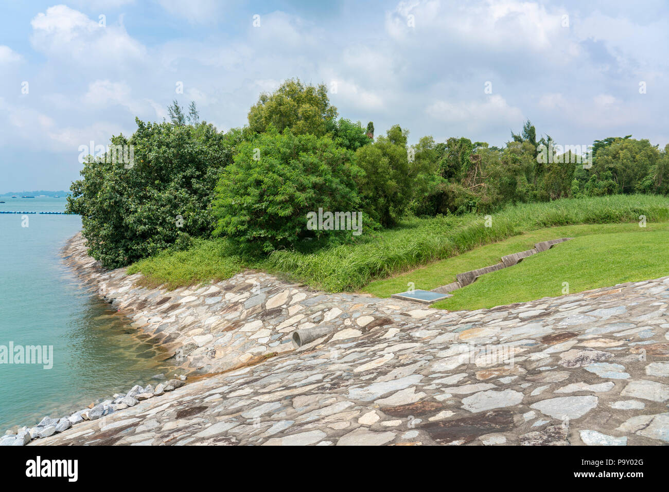 Singapore - july 15, 2018:  Storm drain to sea. Due to the amount of rain Singapore has a large amount of Storm Drains. - Stock Image