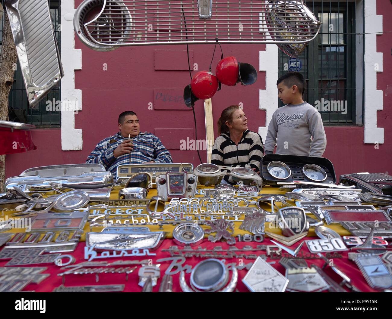 Cordoba, Argentina - 2017: A family sell antique car parts at a flee ...