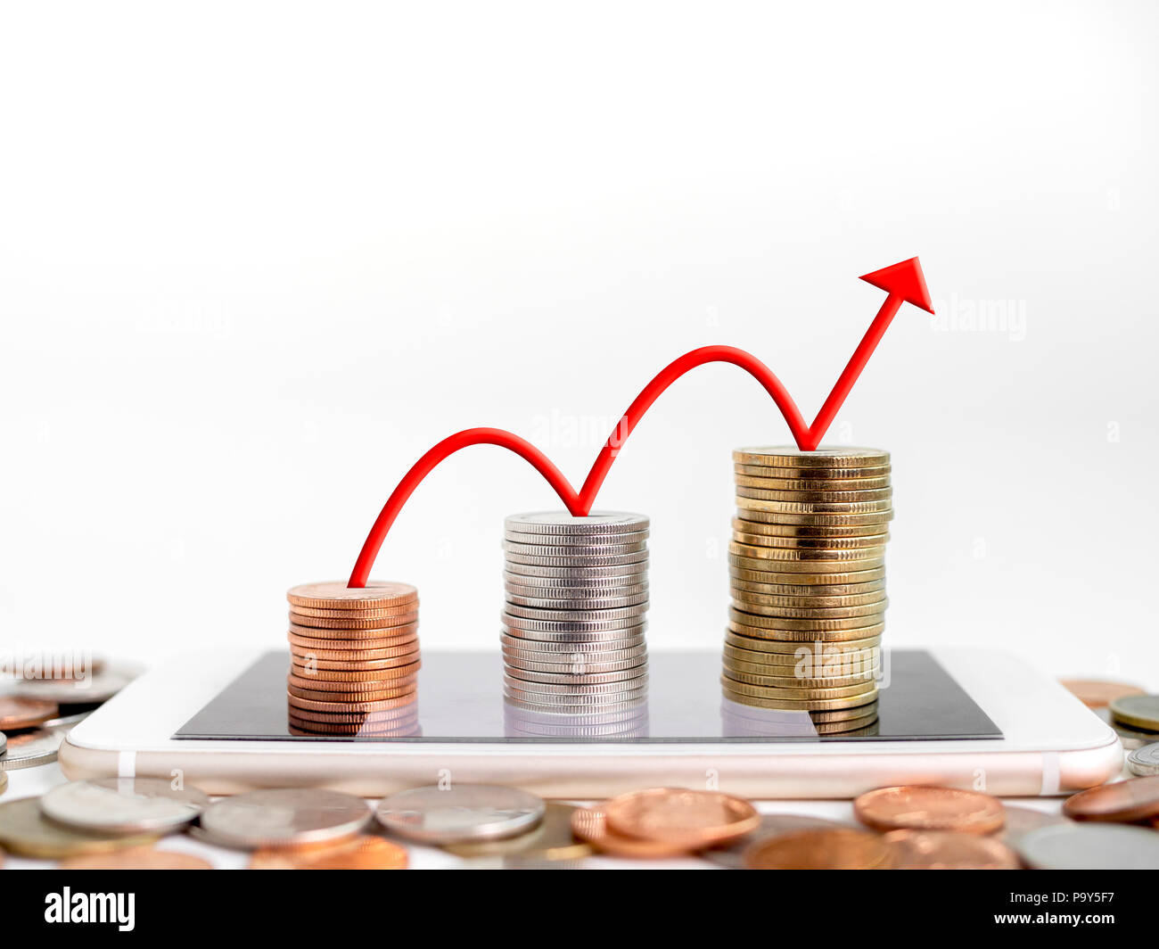 Making money online. Business financial online concept. money, stack of copper, silver and gold Coins on mobile Phone with red rising up arrow graph o - Stock Image