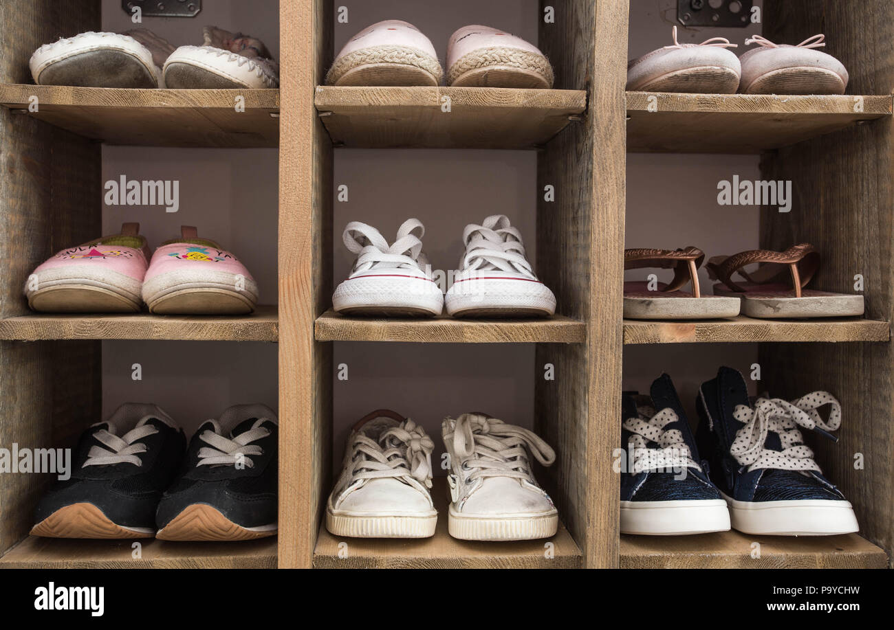 523ae83d165405 Indoor Shoe Rack of sneakers lovers shoes. - Stock Image