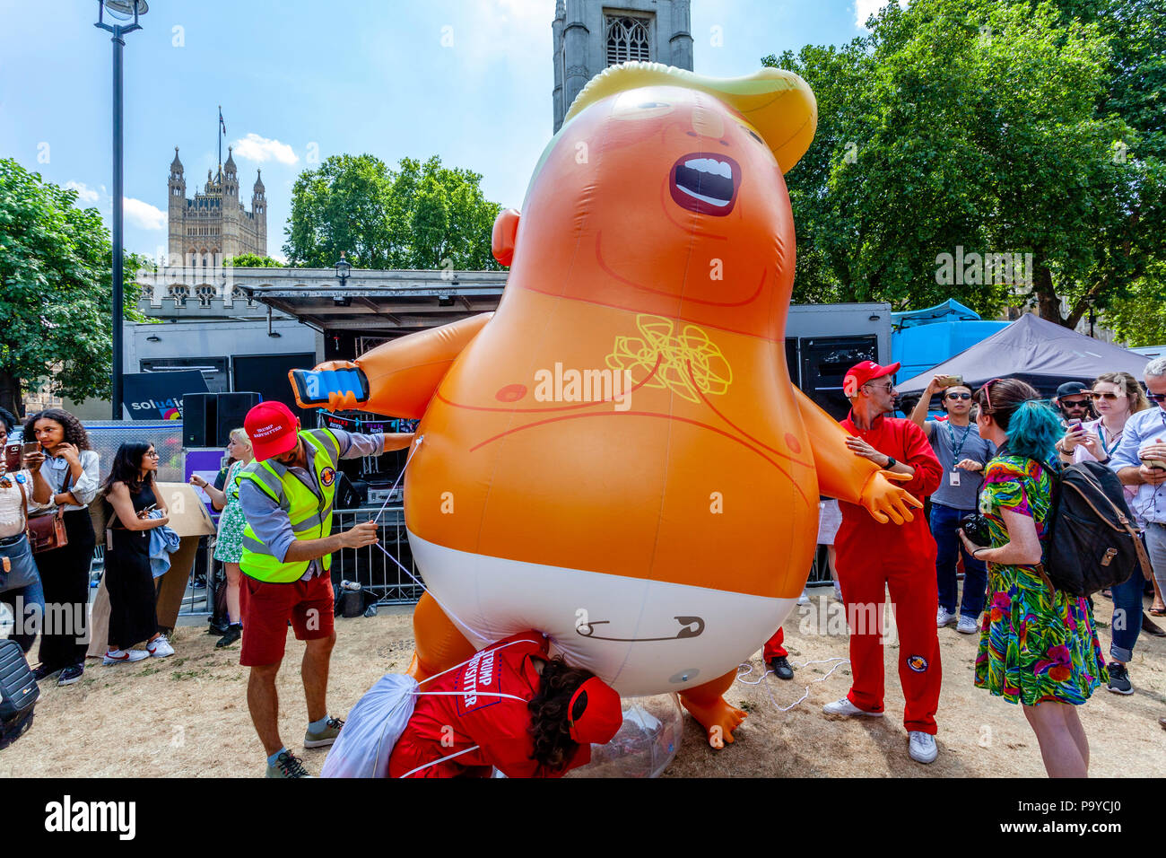 A Group Of Anti Trump Protestors With An 'Angry Baby' Inflatable Blimp, Parliament Square, London, England - Stock Image