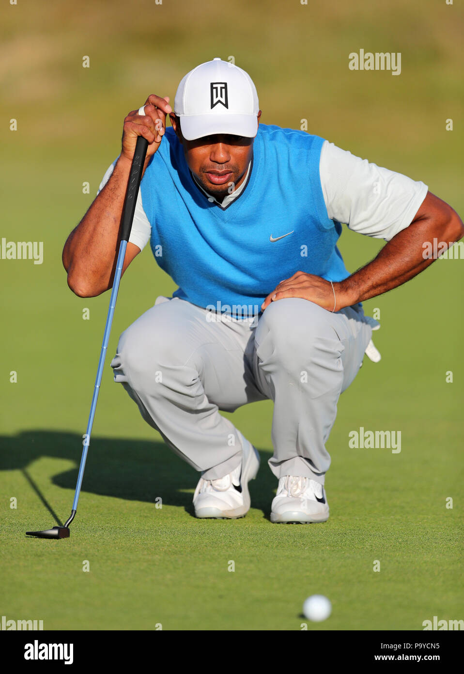 f3212c437 USA's Tiger Woods lines up a putt on the 15th during day one of The ...