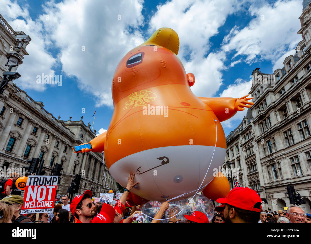 Anti Trump Protestors Carry An 'Angry Baby' Inflatable Blimp Mocking The President Through The Streets Of Central London, London, England - Stock Image