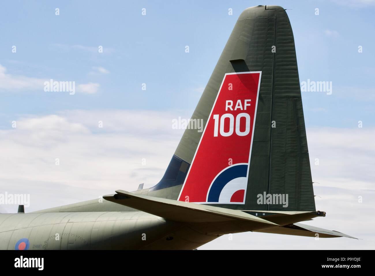 RAF100 Logo on a RAF Hercules vertical stabiliser and rudder at the 2018 Royal International Air Tattoo - Stock Image