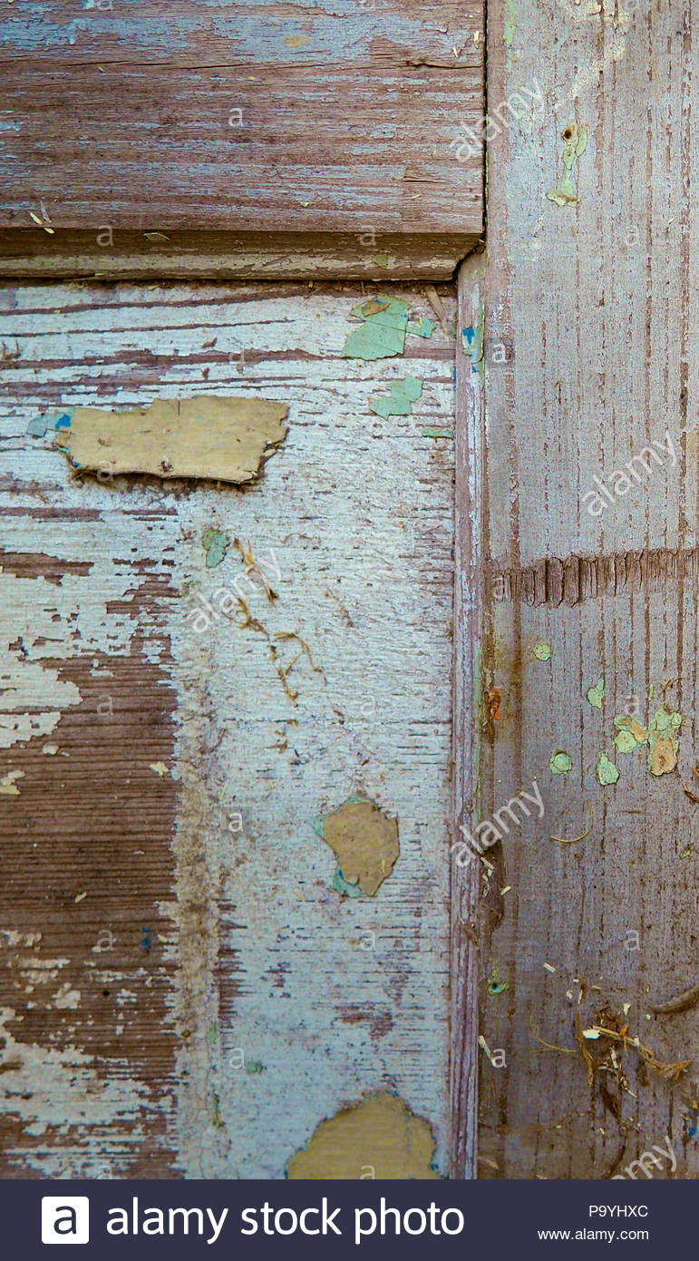 A close up of an old blue door with chipping paint - Stock Image