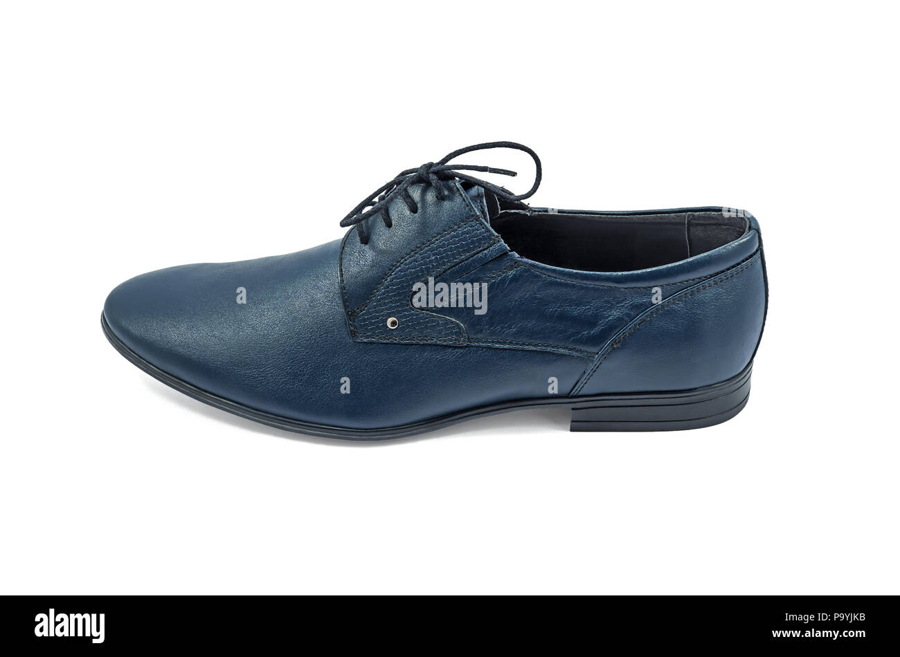Left men's fashionable shoes dark blue color, classic design on a white background isolated - Stock Image