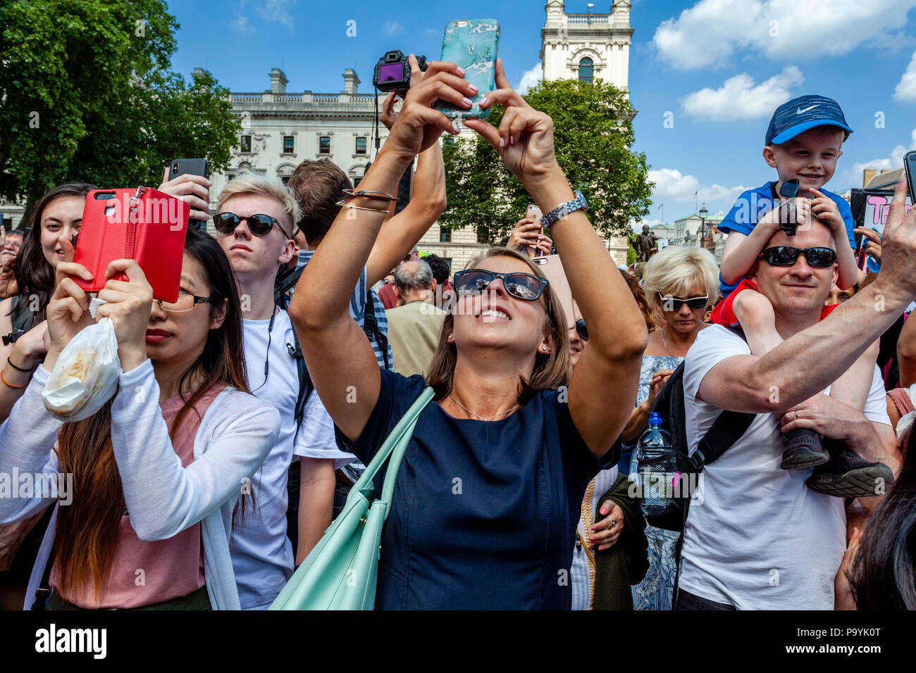 People Taking Photographs In Parliament Square, During An Anti Trump Protest, London, England - Stock Image