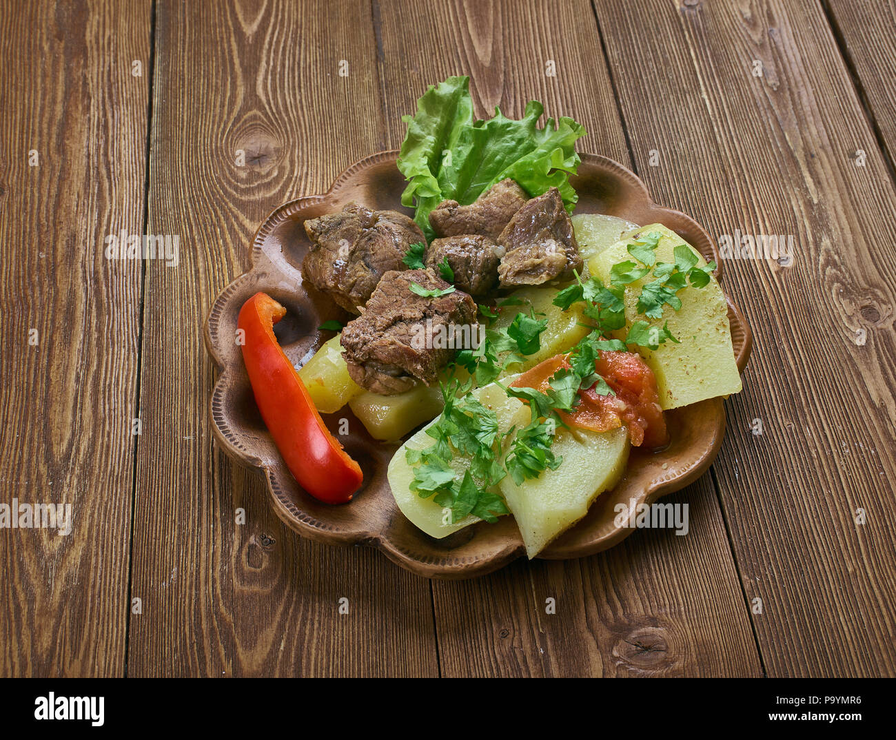 shturyi fyidyi lyivza - Ossetian dish with half-mulled beef and potatoes,  caucasian cuisine. - Stock Image