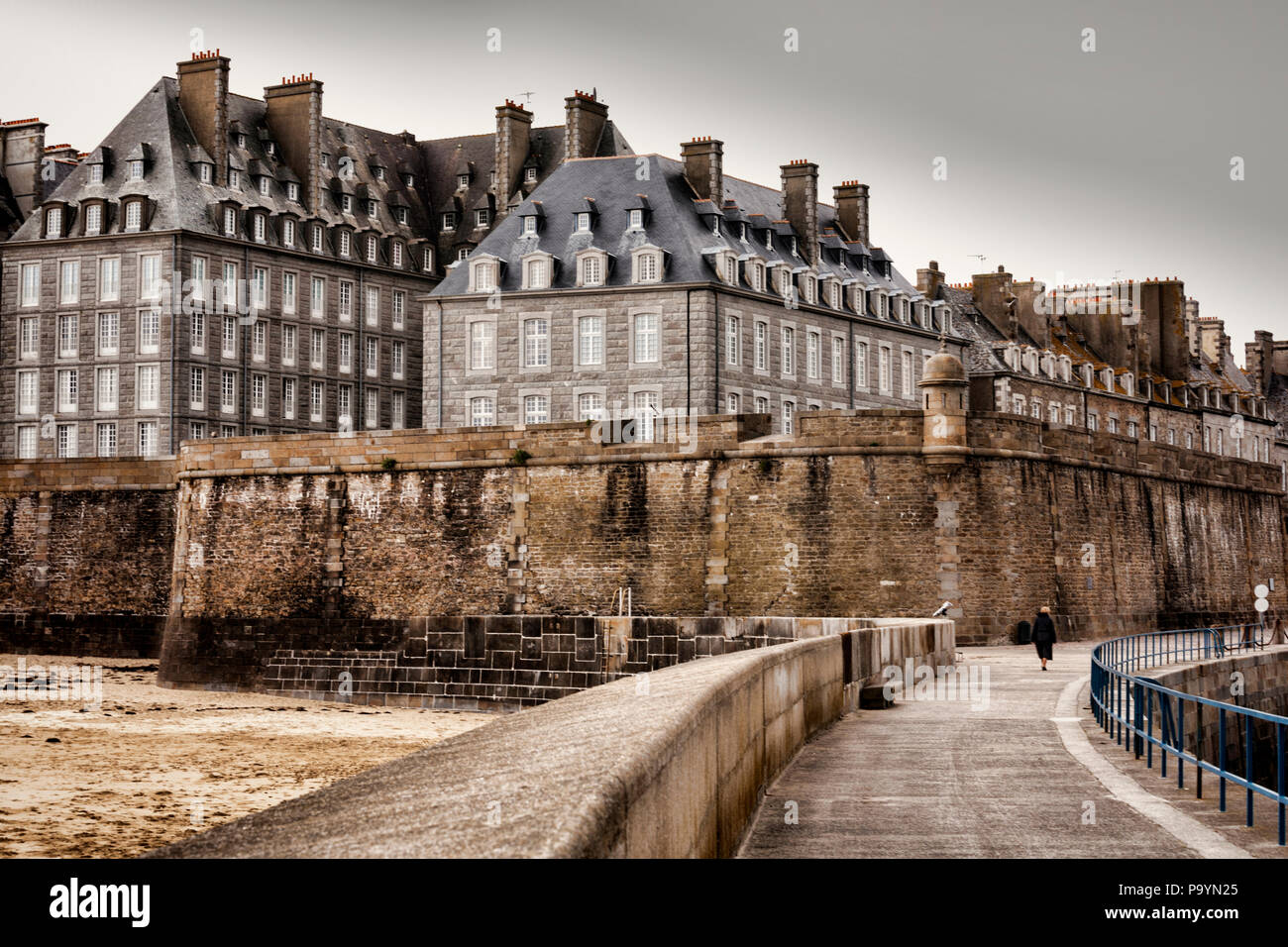 The old town and ramparts of Saint-Malo in flat light. - Stock Image
