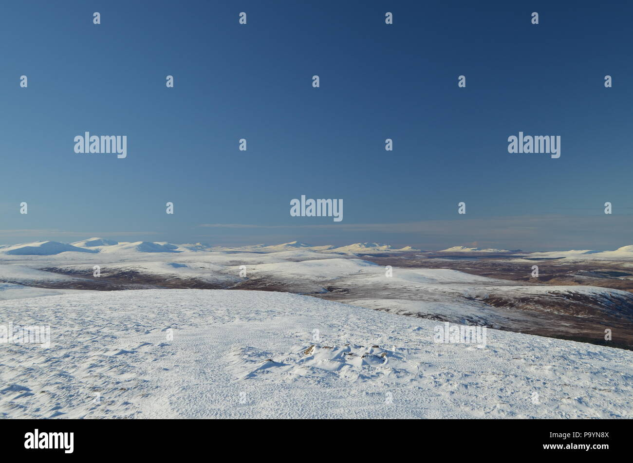 Snow capped hills in the northern Scottish Highlands - Stock Image
