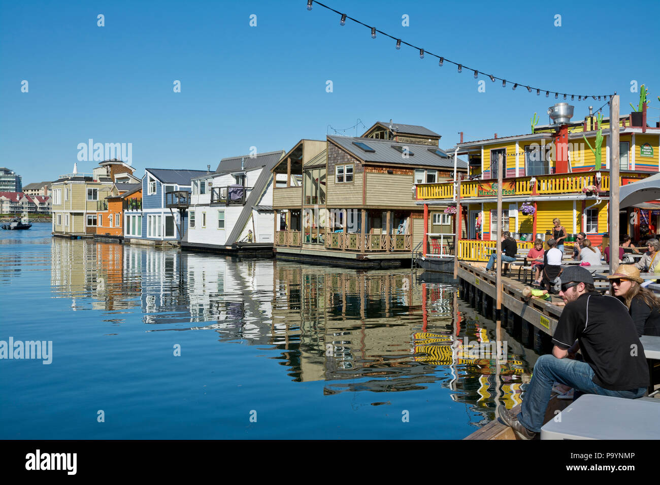 Fisherman's Wharf in Victoria, British Columbia, Canada.  Colourful float homes and restaurant at Fisherman's Wharf in Victoria, BC. Stock Photo