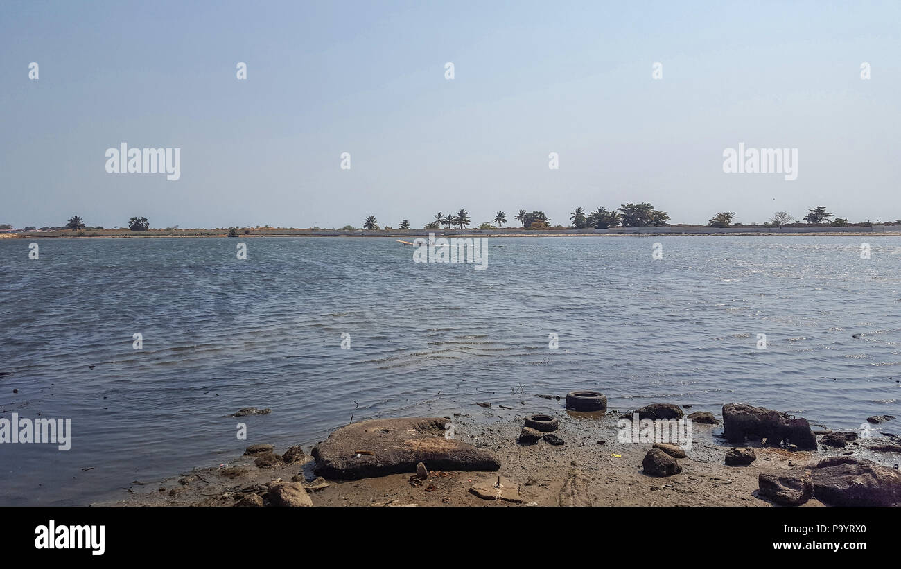 View of the bay of the new marginal in Luanda, with birds, fisherman boat, island and Atlantic ocean, Angola - Stock Image