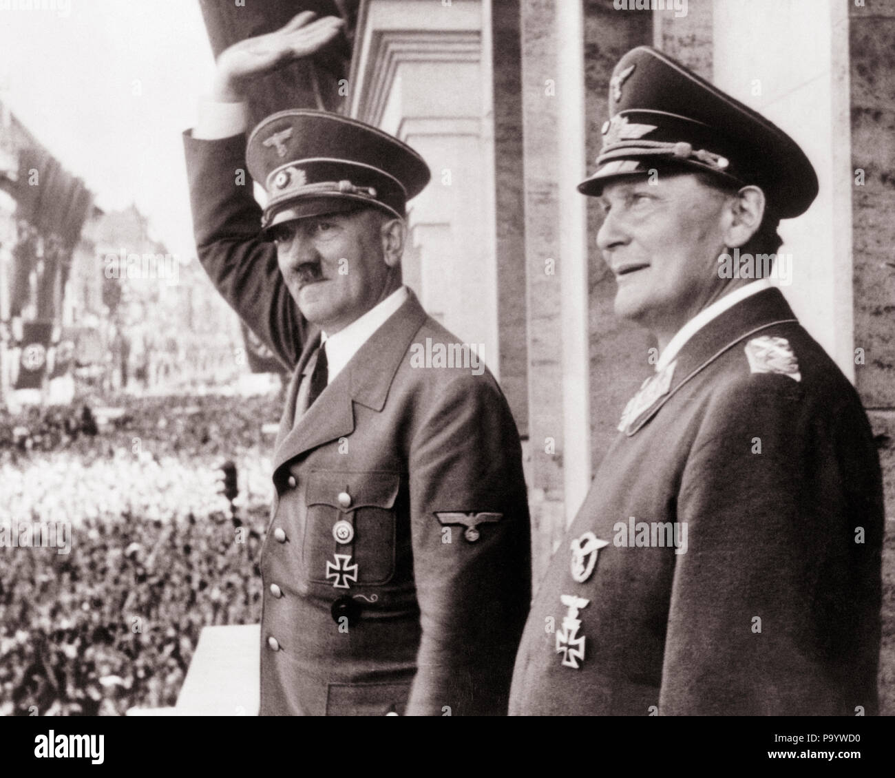1930s 1940s ADOLF HITLER AND HERMANN GOERING ON BALCONY WAVING TO CROWD CIRCA 1938  - q72076 CPC001 HARS POWERFUL WORLD WARS WORLD WAR WORLD WAR TWO WORLD WAR II DICTATOR AUTHORITY FACIAL HAIR OCCUPATIONS POLITICS UNIFORMS 1938 NAZI WORLD WAR 2 ADOLF HITLER CIRCA MOUSTACHED SALUTING BLACK AND WHITE CAUCASIAN ETHNICITY OLD FASHIONED - Stock Image