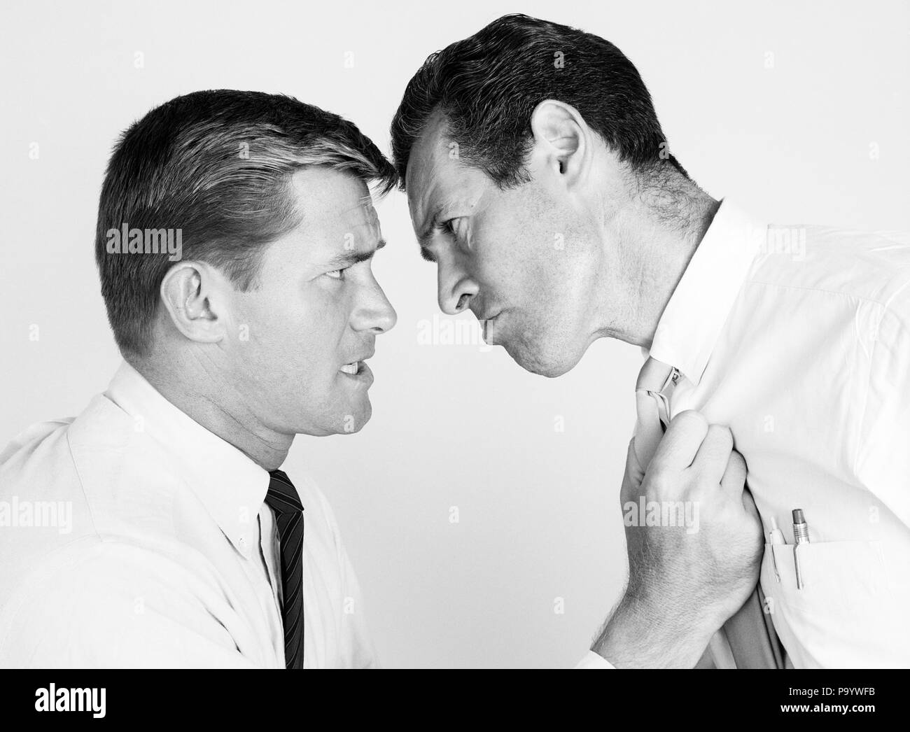 1950s 1960s TWO BUSINESSMEN HEAD TO ARGUING