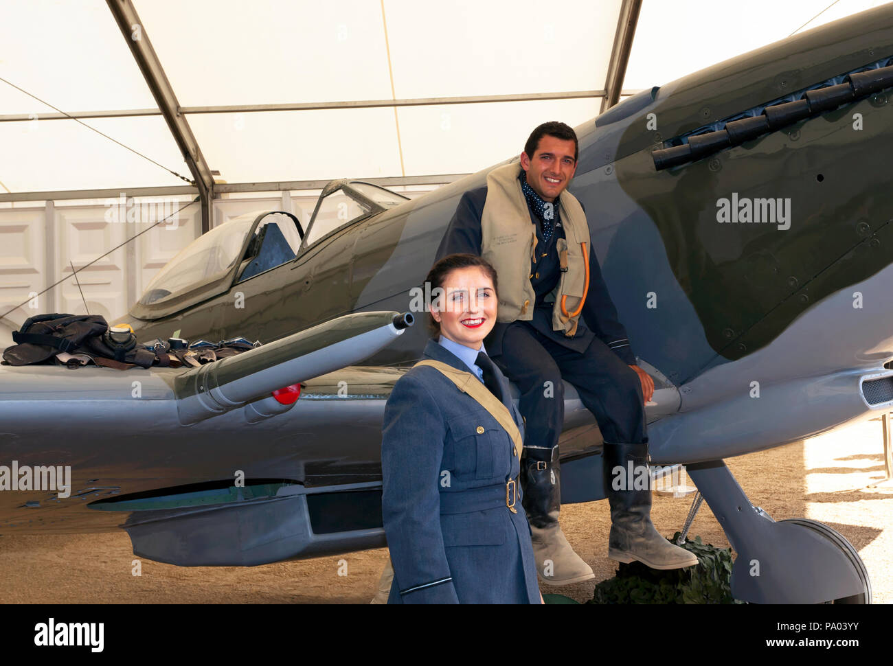 Man and Woman in period uniform, pose  by a  Supermarine Spitfire Mk XVI, part of the RAF Centennial Celebrations at  Horse Guards  Parade, London. - Stock Image